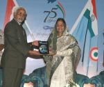 The President, Smt. Pratibha Devisingh Patil and the Vice President, Shri M. Hamid Ansari releasing a book on Air Power on the occasion of IAF's Platinum Jubilee Celebrations, in New Delhi on October 08, 2007