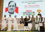 Shri M. Hamid Ansari, Hon'ble Vice President of India giving away the Lokmat Parliamentary Award 2017 to the Member of Parliament (RS), Shri Sharad Yadav, in New Delhi on July 19, 2017.